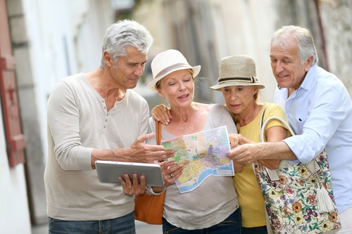 Group of tourists looking at a map